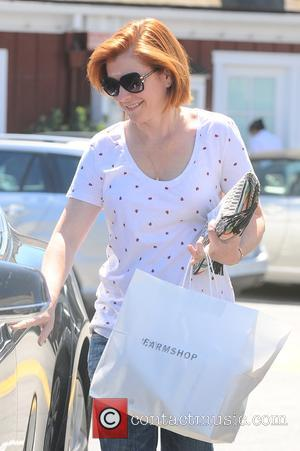 Alyson Hannigan - Alyson Hannigan shopping for groceries at the Farm Shop - Los Angeles, California, United States - Thursday...