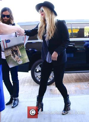 Kesha and Brad Ashenfelter