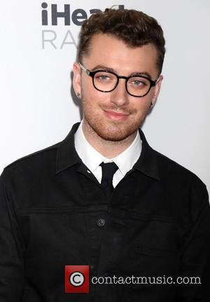 Sam Smith's 'Writing's On The Wall' Becomes First Bond Theme To Reach Number One