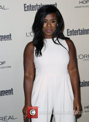 Uzo Aduba - 2015 Entertainment Weekly Pre-Emmy Party at Fig & Olive Melrose Place - Arrivals at Fig & Olive...