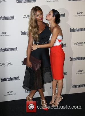 Laverne Cox , Angie Harmon - 2015 Entertainment Weekly Pre-Emmy Party at Fig & Olive Melrose Place - Arrivals at...