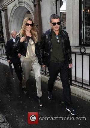Antonio Banderas , Nicole Kimpel - Antonio Banderas and girlfriend Nicole Kimpel seen leaving Victoria Beckhams' store in Mayfair -...