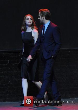 Emma Stone , Ryan Gosling - Emma Stone and Ryan Gosling hold hands while shooting an early morning nightclub scene...
