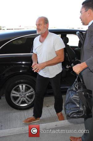 Kelsey Grammer - A dressed down Kelsey Grammer and his wife Kayte Walsh depart from Los Angeles International Airport (LAX)...