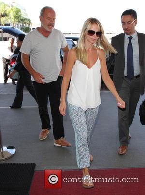 Kelsey Grammer , Kayte Walsh - A dressed down Kelsey Grammer and his wife Kayte Walsh depart from Los Angeles...