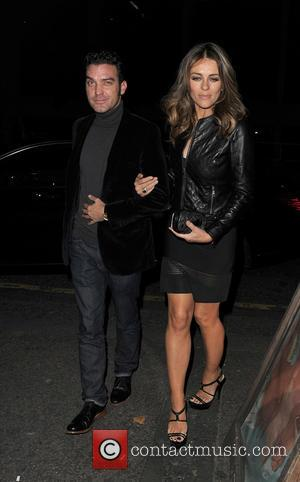 Elizabeth Hurley , Jake Maskall - Elizabeth Hurley appears very close to her on screen husband Jake Maskall, during a...
