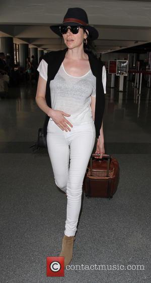 Laura Prepon - Orange Is The New Black star, Laura Prepon departs from Los Angeles International Airport (LAX) in white...