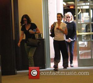Courteney Cox - Courteney Cox wearing her spectacles, out and about in Beverly Hills running errands at beverly hills -...