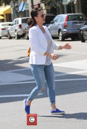 Kyle Richards - Kyle Richards wearing a white jacket with blue jeans goes shopping in Beverly Hills - Los Angeles,...