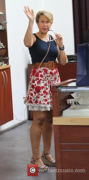 Yeardley Smith - Yeardley Smith goes shopping in Beverly Hills in a tight blue top and red floral skirt -...
