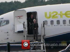 Adam Clayton - Members of the band U2 flying into Berlin-Schönefeld airport on a private jet. - Berlin, Germany -...