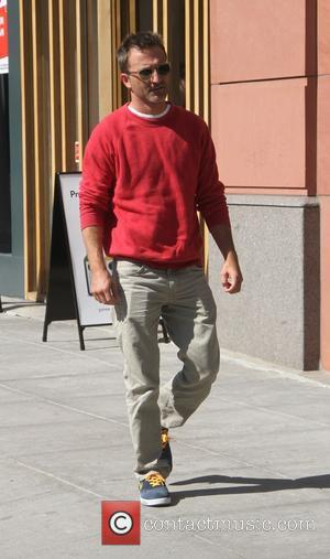 Breckin Meyer - Breckin Meyer wearing a red sweatshirt, goes shopping in Beverly Hills - Los Angeles, California, United States...