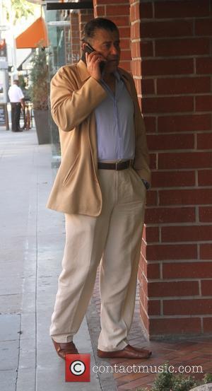 Haim Saban - American-Israeli billionaire Haim Saban talking on his cell phone in Beverly Hills - Los Angeles, California, United...