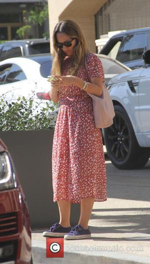 Jennifer Meyer - Jennifer Meyer goes shopping in Beverly Hills in a red floral dress and sneakers - Los Angeles,...