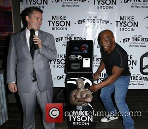 Peter Lkamka and Mike Tyson