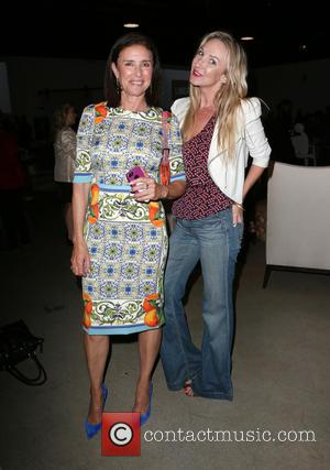 Mimi Rogers and Guest