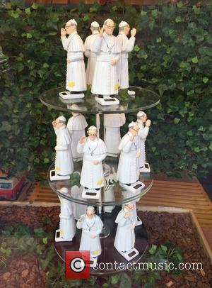 Atmosphere - Pope Francis ornaments go on sale at a store on New York's 8th Avenue to celebrate his visit...