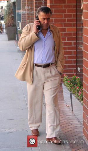 Haim Saban - American-Israeli billionaire Haim Saban talking on his cell phone in Beverly Hills at beverly hills - Los...