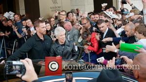Adam Clayton - U2 band member Adam Clayton is seen greeting fans outside of the Waldorf Astoria Hotel. Fans have...