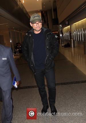 Christian Slater - Christian Slater arrives at Los Angeles International Airport (LAX) - Los Angeles, California, United States - Friday...