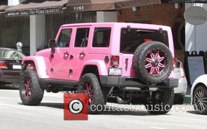 Amber Rose - Amber Rose and her assistant seen driving in Amber's custom gaint bright pink Jeep in Beverly Hills...