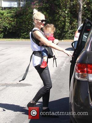 Gwen Stefani - Gwen Stefani has her left ear tugged by youngest son, Apollo, as they walk to church. Her...