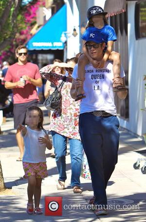 Johnny Knoxville, Rocko Clapp , Arlo Clapp - Johnny Knoxville gives his son Rocko a ride on his shoulders during...
