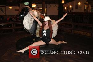 Phoebe Price - Phoebe Price and friends take turns riding a mechanical bull during her 43rd birthday celebrations at Universal...