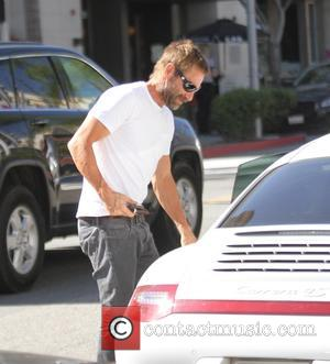 Aaron Eckhart - Aaron Eckhart drives his white Porsche and has lunch in Beverly Hills - Los Angeles, California, United...
