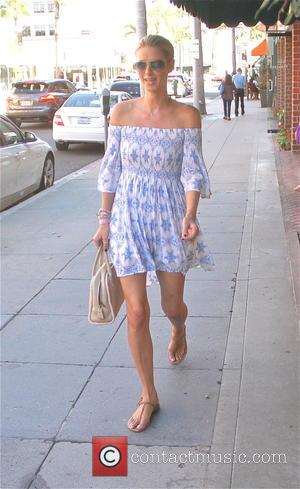 Nicky Hilton - Nicky Hilton goes shopping in Beverly Hills wearing a blue off the shoulder summer dress - Los...