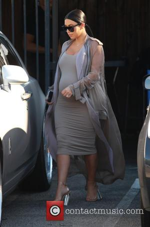 Kim Kardashian - Heavily pregnant Kim Kardashian drives her own Rolls Royce with husband Kanye West as passenger when leaving...