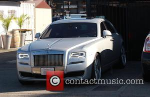 Kim Kardashian , Kanye West - Heavily pregnant Kim Kardashian drives her own Rolls Royce with husband Kanye West as...