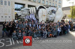 Emma Thompson - Emma helps volunteers puppeteers move Aurora the double decker bus sized polar bear from in front of...