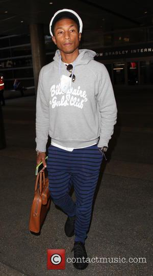 Pharrell Williams - Pharrell Williams departs from Los Angeles International Airport (LAX) - Los Angeles, California, United States - Wednesday...