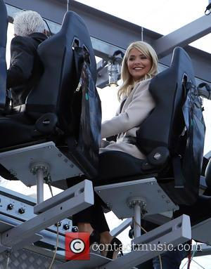 Holly Willoughby , Phillip Schofeild - Holly Willoughby and Phillip Schofield filming on a platform floating in the air outside...