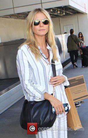 Heidi Klum - Heidi Klum arrives at Los Angeles International Airport (LAX) - Los Angeles, California, United States - Thursday...