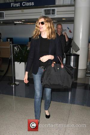 Rene Russo , Dan Gilroy - Rene Russo departs from Los Angeles International Airport (LAX) with her husband Dan Gilroy...