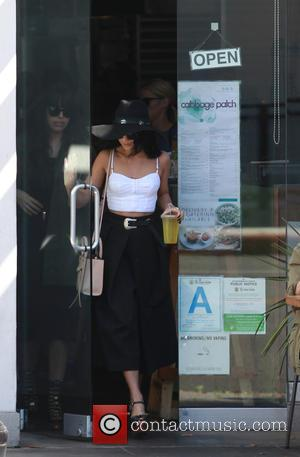 Vanessa Hudgens - Vanessa Hudgens picks up lunch to go from Cabbage Patch restaurant in Beverly Hills, with a group...