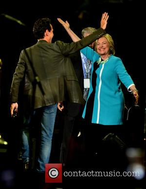 Marc Anthony and Hillary Clinton