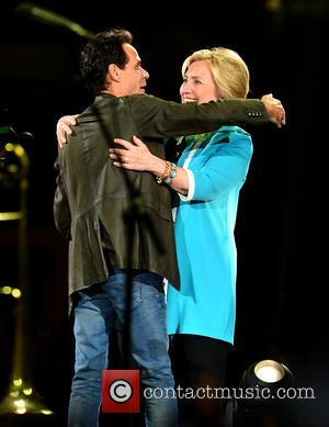 Marc Anthony , Hillary Clinton - Marc Anthony performs at the American Airlines Arena, and is joined on stage by...