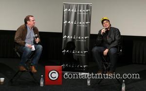 Benicio Del Toro and Guest