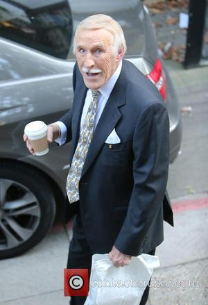 Sir Bruce Forsyth - Sir Bruce Forsyth outside the ITV Studios holding a cup of coffee - London, United Kingdom...