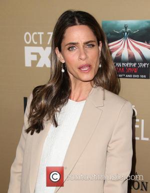 Amanda Peet - Premiere screening of FX's 'American Horror Story: Hotel' at Regal Cinemas L.A. Live - Arrivals at Regal...