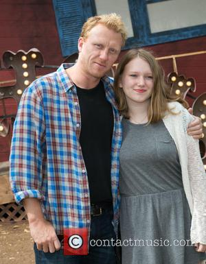 Kevin McKidd , Iona McKidd - Celebrities attend the Goosebumps Red Carpet Premiere at Westwood Village Theatre. at Westwood Village...