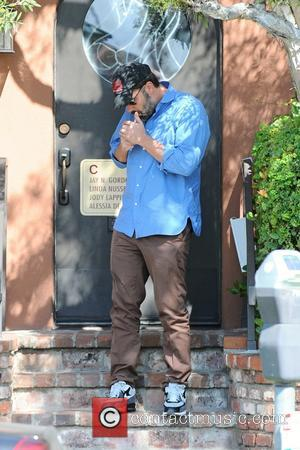 Ben Affleck - Ben Affleck lights a cigarette as he leaves a medical building in Brentwood - Brentwood, California, United...