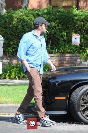 Ben Affleck - Ben Affleck smokes a cigarette as he leaves a medical building in Brentwood - Brentwood, California, United...