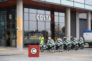 David Cameron and Police Escort Waits For The Prime Minister Media City