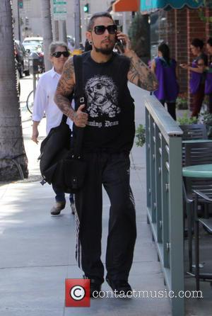 Dave Navarro - Dave Navarro talks on his cell phone whilst out in Beverly Hills at beverly hills - Los...