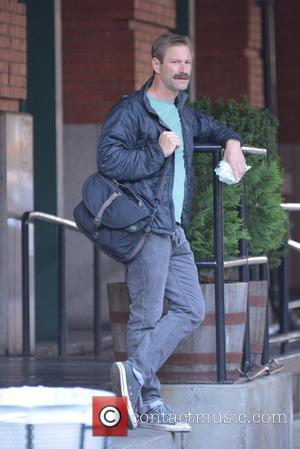 Aaron Eckhart - Aaron Eckhart sports a bushy mustache while out in TriBeCa - New York City, New York, United...