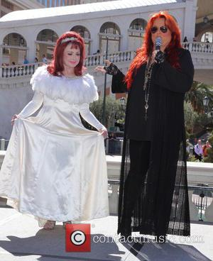 Naomi Judd , Wynonna Judd - Wynonna and Naomi Judd arrive at The Venetian in a classic 57 Chevy for...